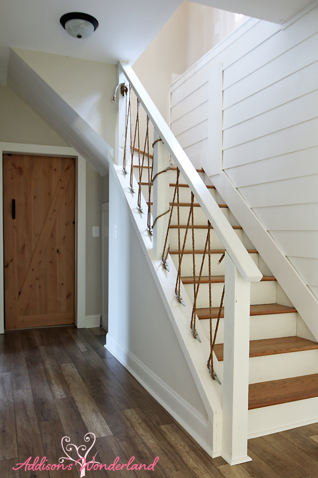 Lakehouse White Shiplap Wall Nautical Rope Stair Railing Barn Door