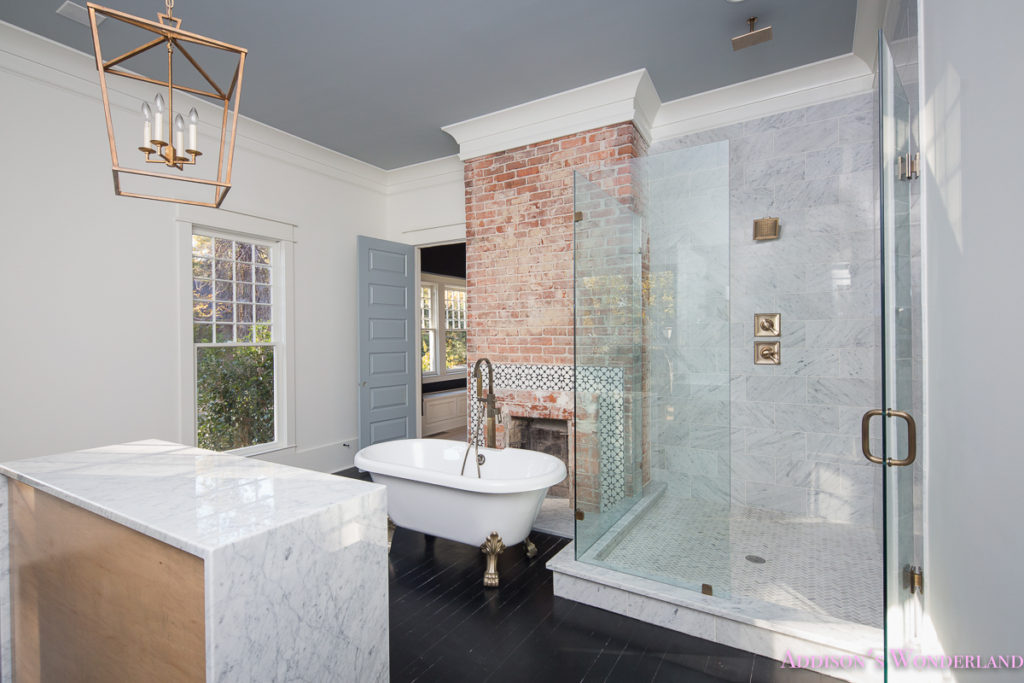 master-bathroom-marble-wall-tile-rustic-modern-vintage-antique-brass-faucet-gray-whitewashed-maple-cabinet-vanity-clawfoot-tub