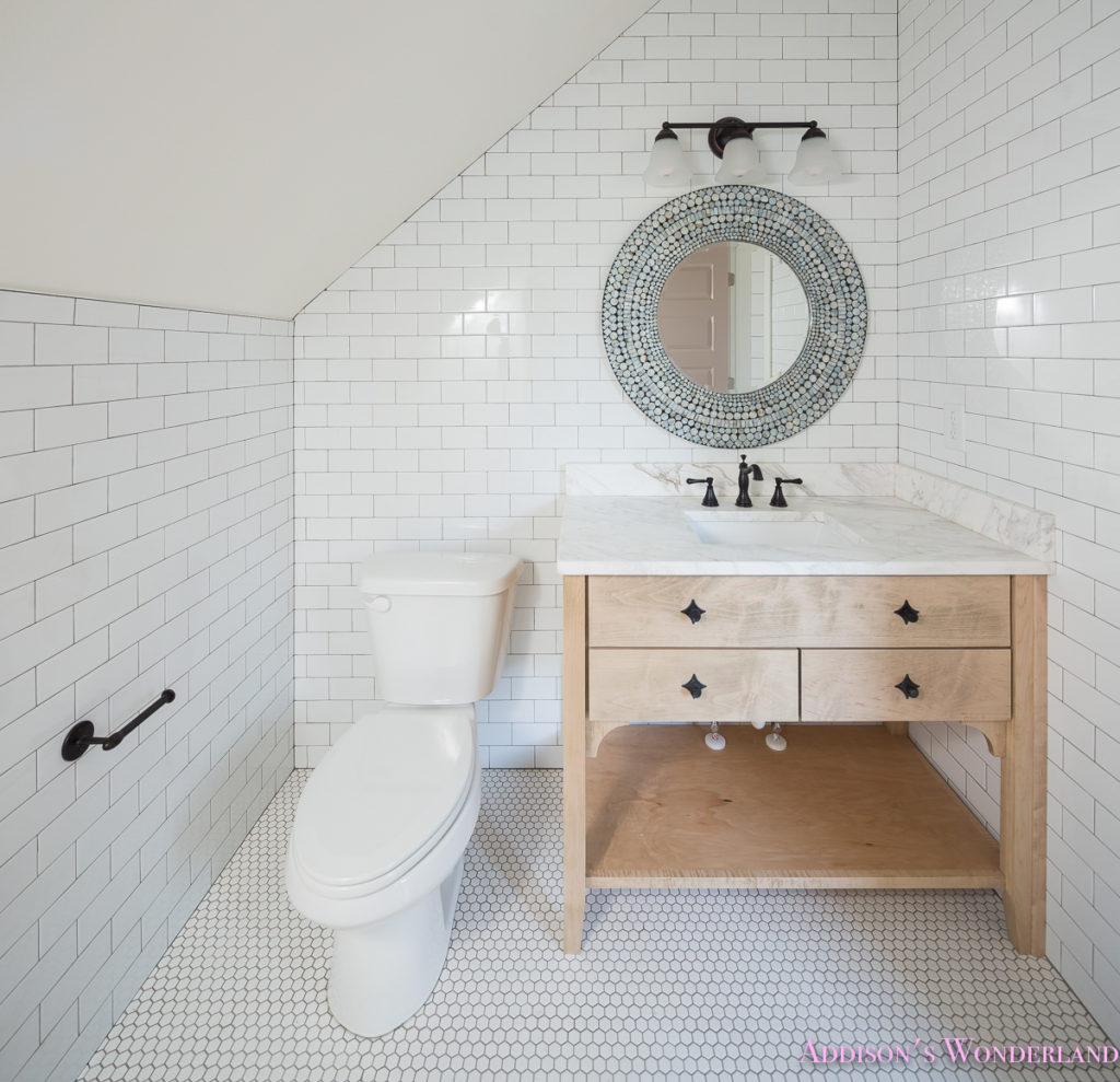 whitewashed-vanity-bathroom-cabinet-white-subway-tile-dark-grout-hexagon-white-tile-floors
