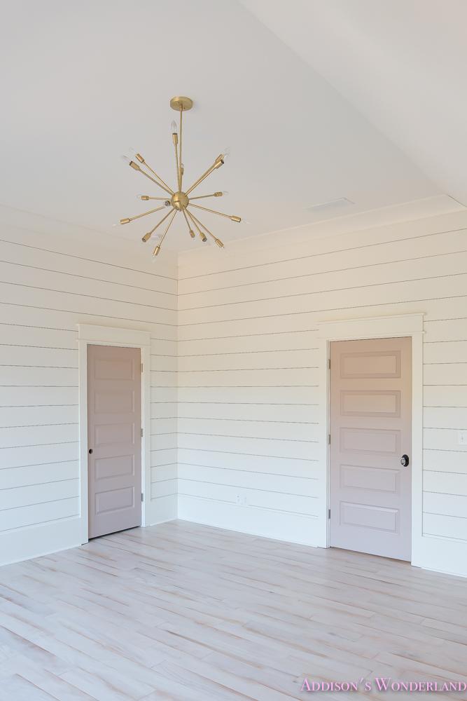 shaw-floors-whitewashed-hardwood-flooring-white-shiplap-walls-rose-quartz-doors-5-of-12