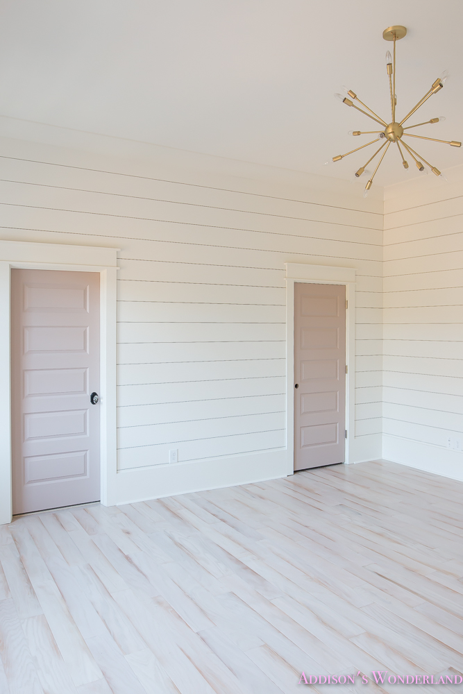 shaw-floors-whitewashed-hardwood-flooring-white-shiplap-walls-rose-quartz-doors-7-of-12