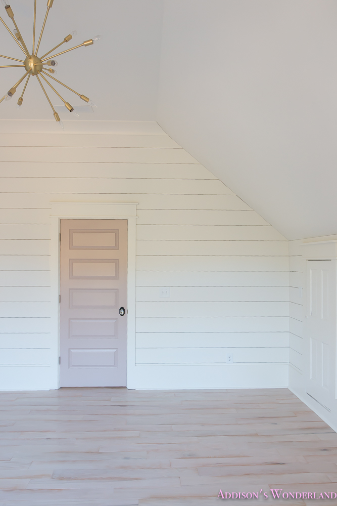 shaw-floors-whitewashed-hardwood-flooring-white-shiplap-walls-rose-quartz-doors-8-of-12
