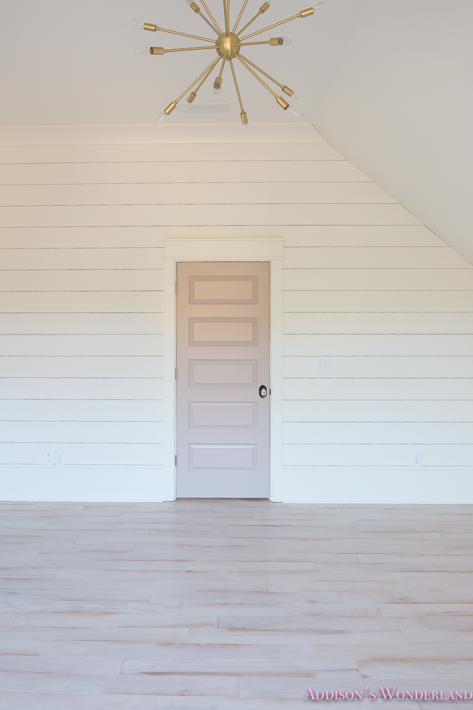 shaw-floors-whitewashed-hardwood-flooring-white-shiplap-walls-rose-quartz-doors-9-of-12