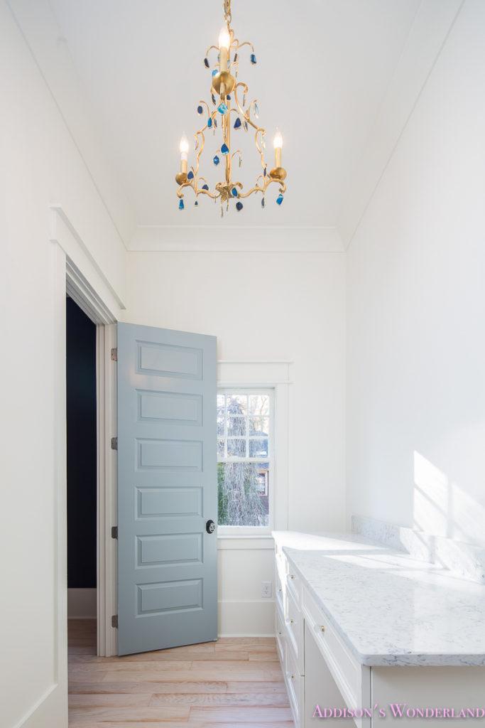 master-closet-dressing-room-alabaster-walls-vanity-bue-gray-door-chandelier-21-of-33