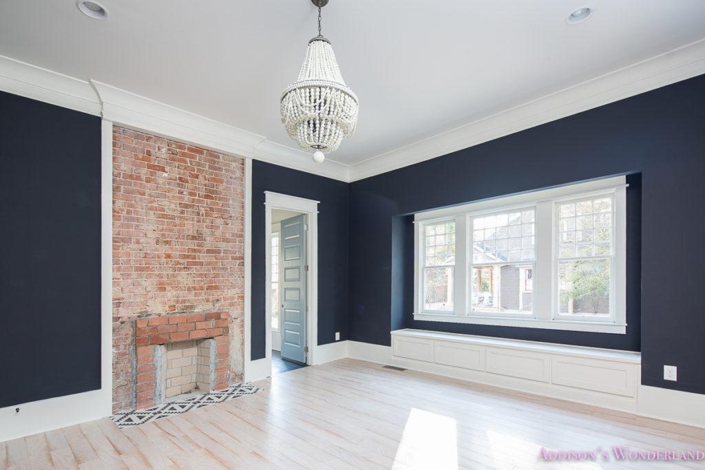 master-bedroom-black-walls-malibu-chandelier-brick-fireplace-inkwell-bluedoors-shaw-whitewashed-hardwood-floors