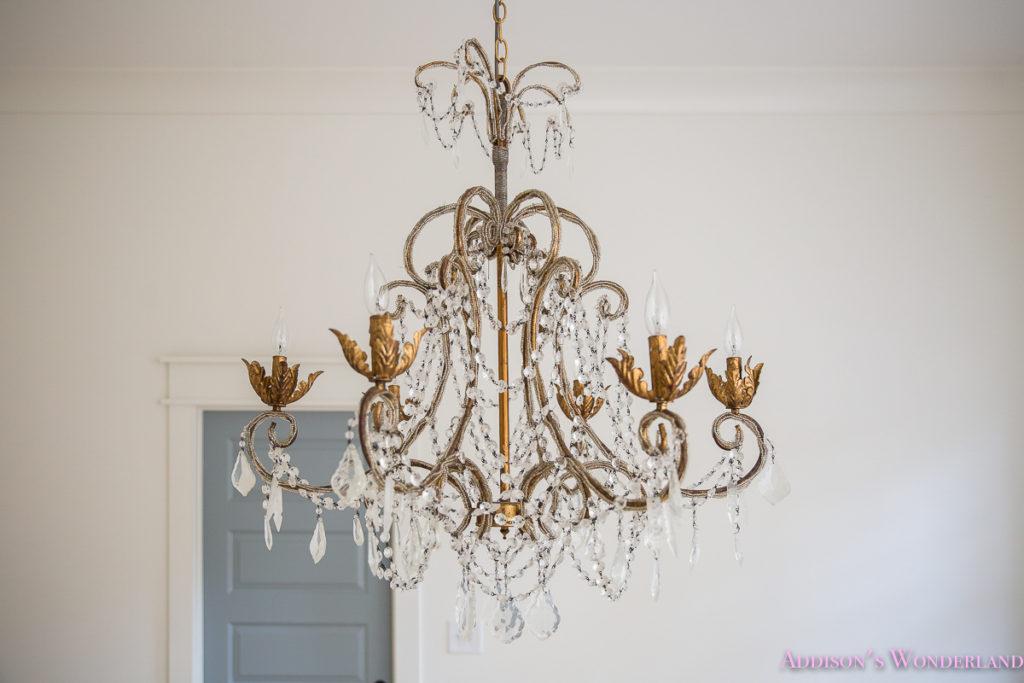 master-closet-dressing-room-alabaster-walls-vanity-bue-gray-door-chandelier-24-of-33