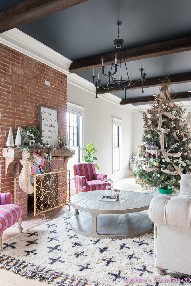 vintage-living-room-black-ceiling-brick-fireplace-dark-wood-beams-anthropologie-home-tufted-sofa-christmas-10-of-23