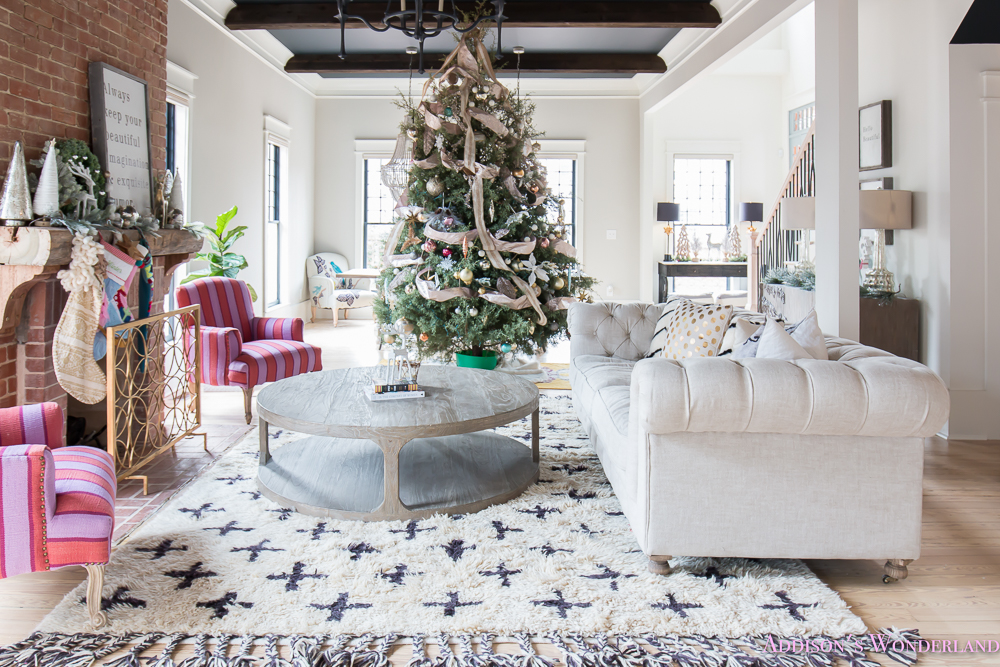 vintage-living-room-black-ceiling-brick-fireplace-dark-wood-beams-anthropologie-home-tufted-sofa-christmas-12-of-23