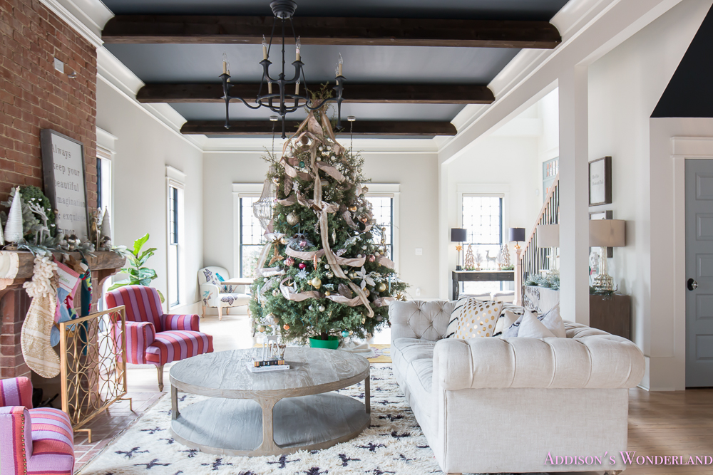 vintage-living-room-black-ceiling-brick-fireplace-dark-wood-beams-anthropologie-home-tufted-sofa-christmas-13-of-23