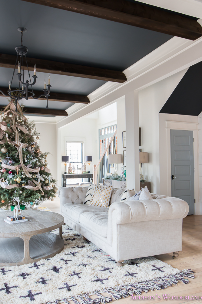 vintage-living-room-black-ceiling-brick-fireplace-dark-wood-beams-anthropologie-home-tufted-sofa-christmas-15-of-23