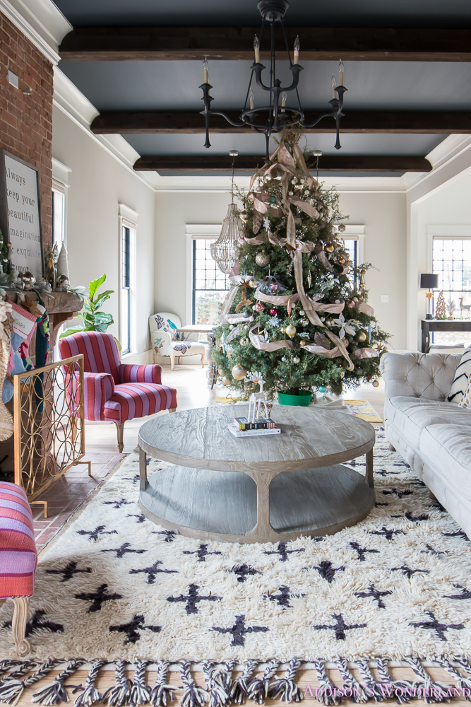 vintage-living-room-black-ceiling-brick-fireplace-dark-wood-beams-anthropologie-home-tufted-sofa-christmas-17-of-23
