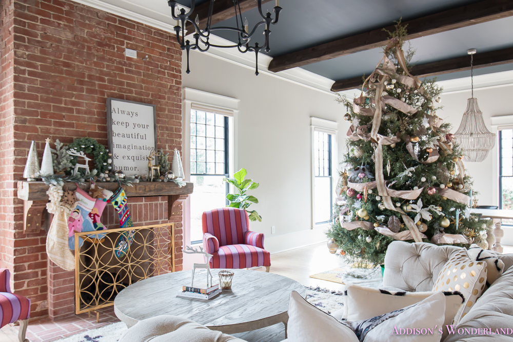 vintage-living-room-black-ceiling-brick-fireplace-dark-wood-beams-anthropologie-home-tufted-sofa-christmas-6-of-23