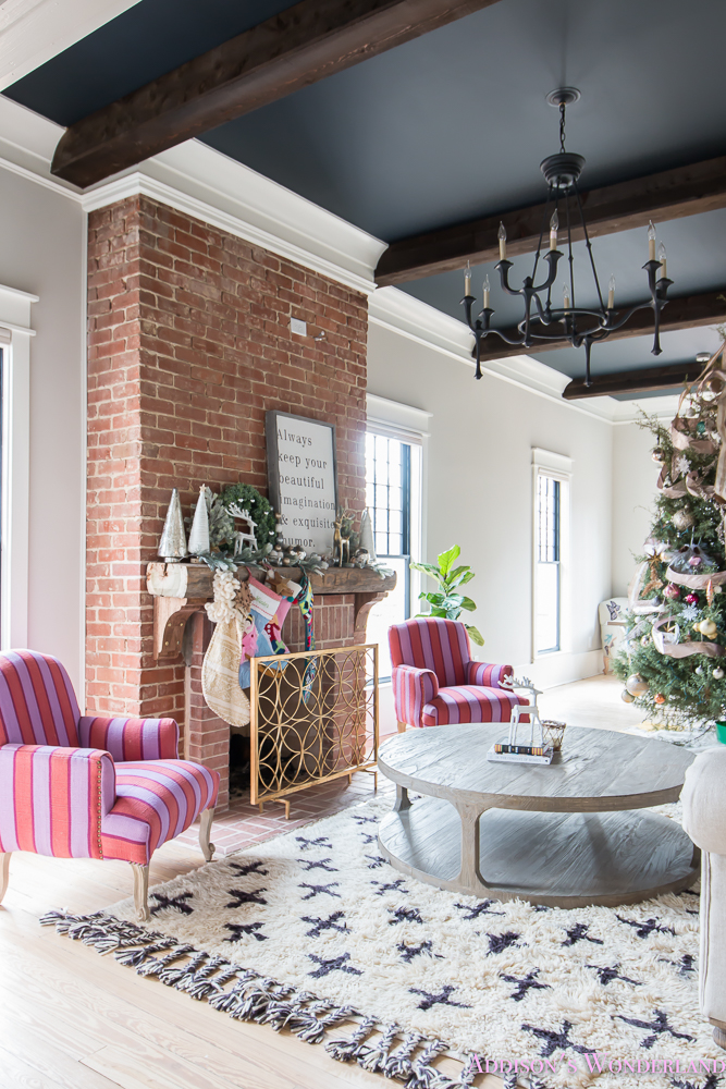 vintage-living-room-black-ceiling-brick-fireplace-dark-wood-beams-anthropologie-home-tufted-sofa-christmas-9-of-23