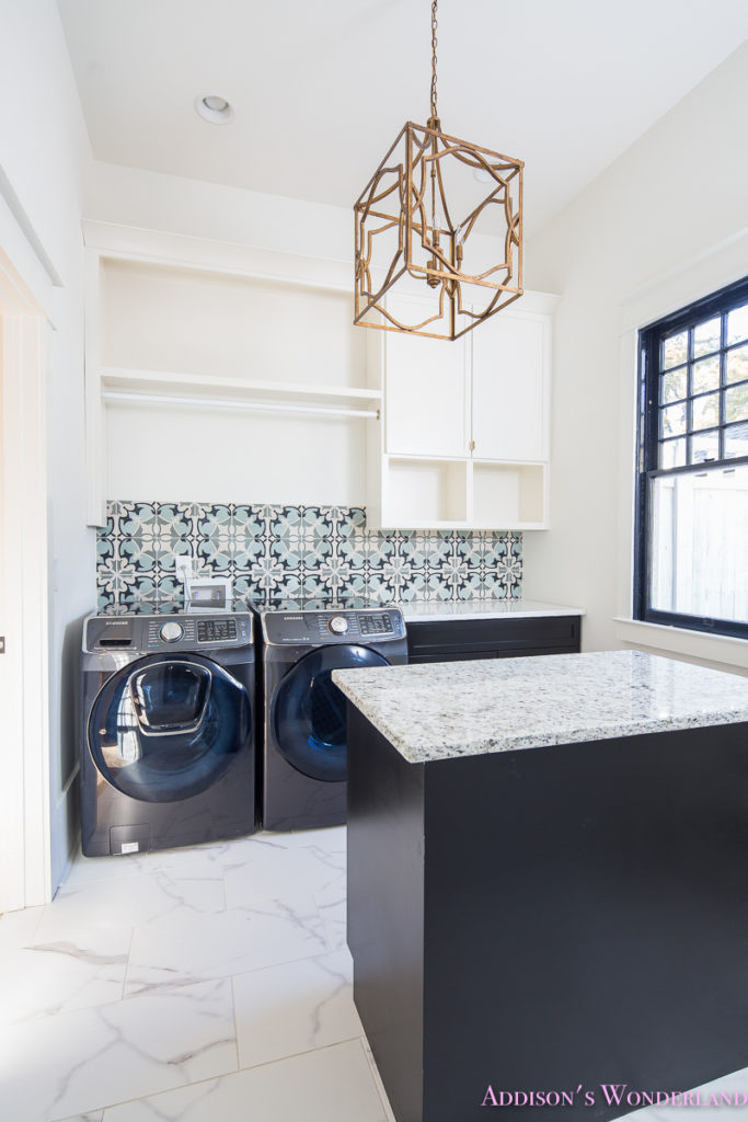 white-marble-porcelain-tile-shaw-floors-gold-lantern-chandelier-cement-tile-laundry-room-decor-1-of-2