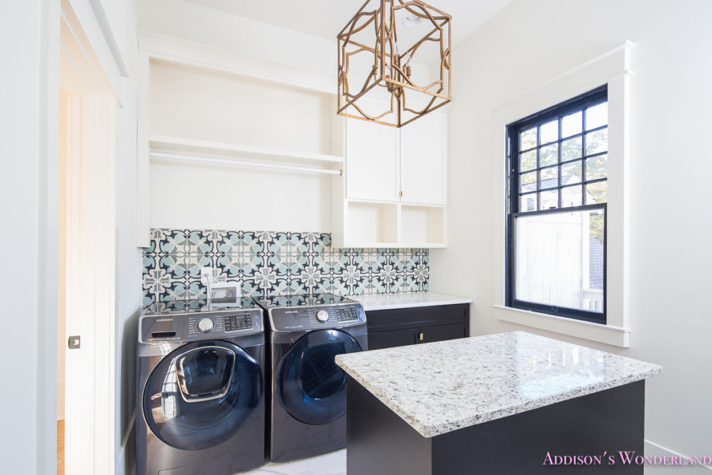 white-marble-porcelain-tile-shaw-floors-gold-lantern-chandelier-cement-tile-laundry-room-decor-2-of-2