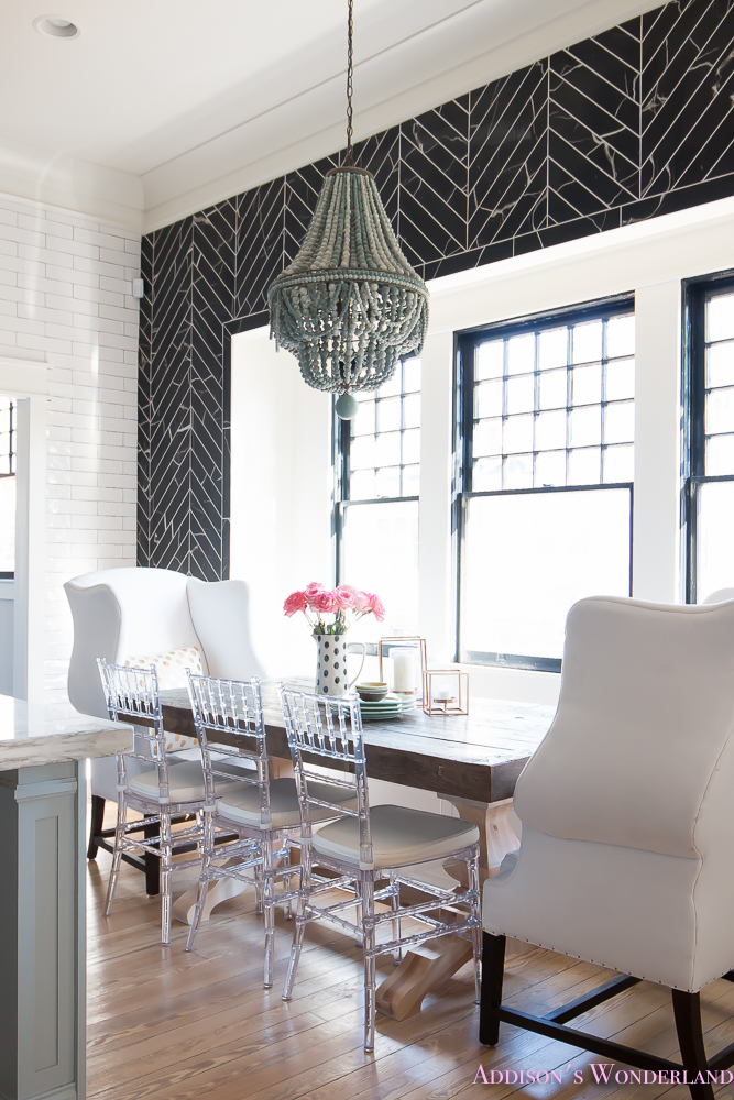 breakfast-room-black-chevron-wall-tile-white-wingback-dining-chairs-wood-table-clear-lucite-chairs-powder-blue-cabinets-10-of-28