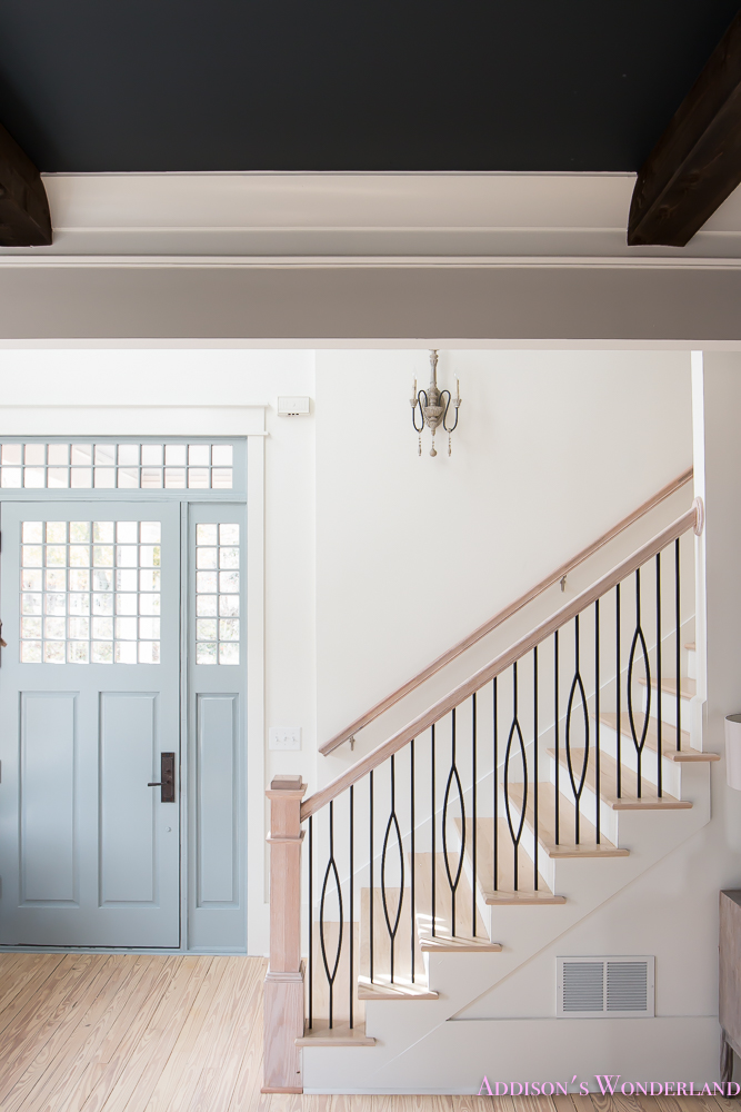 foyer-white-walls-blue-front-foor-uncertain-grey-stardew-alabaster-sherwin-williams-iron-baluster-staircase-whitewashed-hardwood-floors-10-of-13