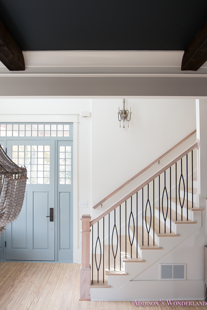 foyer-white-walls-blue-front-foor-uncertain-grey-stardew-alabaster-sherwin-williams-iron-baluster-staircase-whitewashed-hardwood-floors-11-of-13