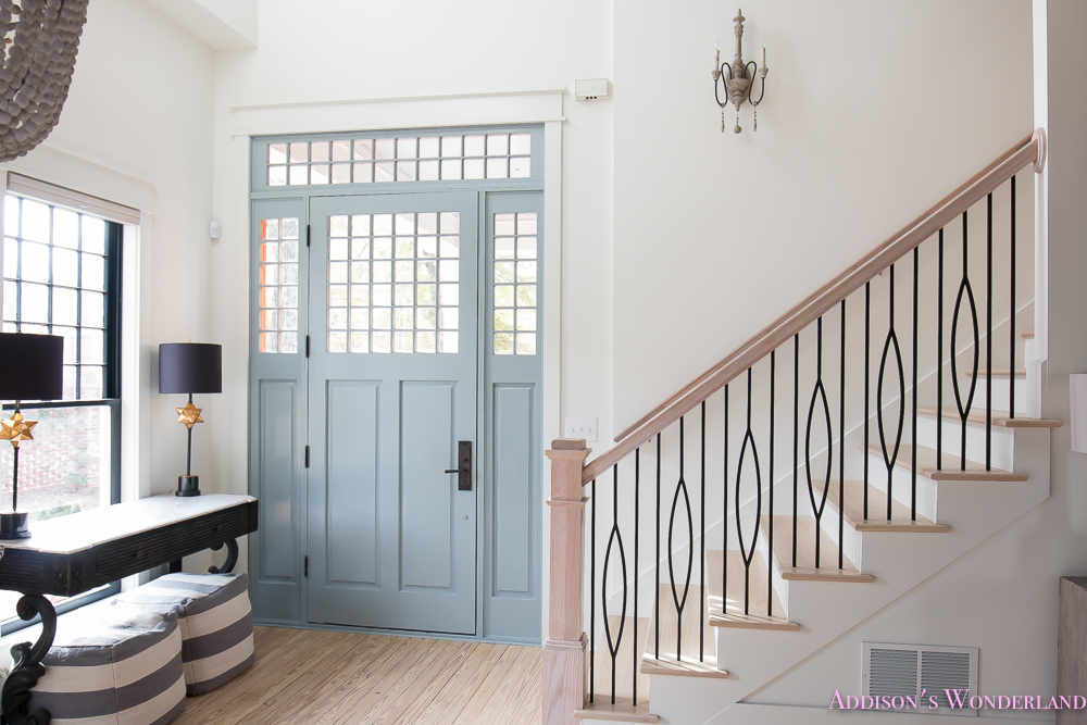 foyer-white-walls-blue-front-foor-uncertain-grey-stardew-alabaster-sherwin-williams-iron-baluster-staircase-whitewashed-hardwood-floors-12-of-13