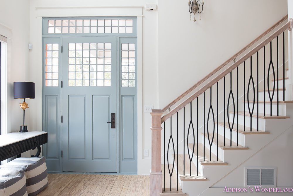 foyer-white-walls-blue-front-foor-uncertain-grey-stardew-alabaster-sherwin-williams-iron-baluster-staircase-whitewashed-hardwood-floors-13-of-13