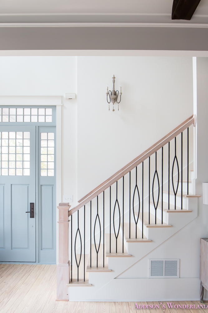 foyer-white-walls-blue-front-foor-uncertain-grey-stardew-alabaster-sherwin-williams-iron-baluster-staircase-whitewashed-hardwood-floors-2-of-13