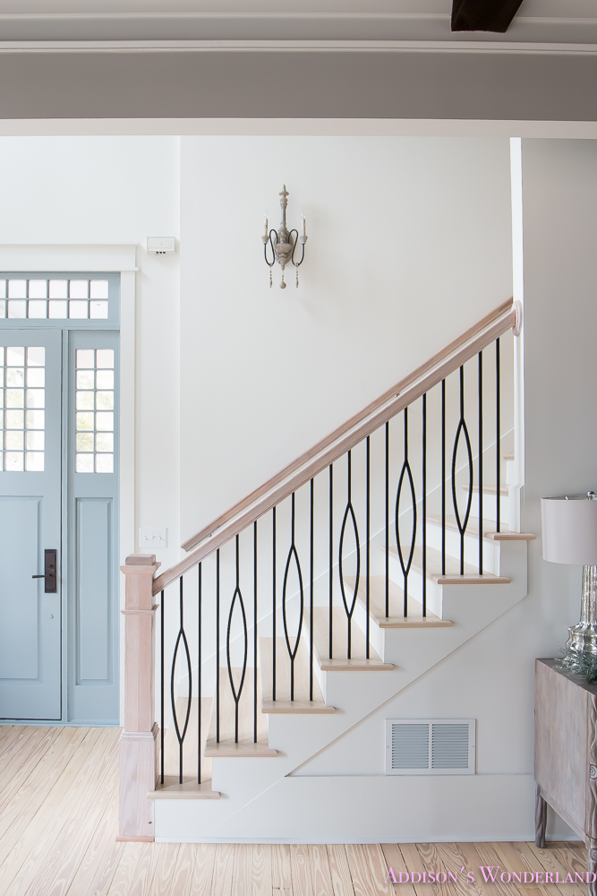 foyer-white-walls-blue-front-foor-uncertain-grey-stardew-alabaster-sherwin-williams-iron-baluster-staircase-whitewashed-hardwood-floors-3-of-13