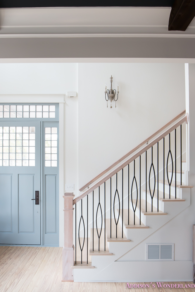 foyer-white-walls-blue-front-foor-uncertain-grey-stardew-alabaster-sherwin-williams-iron-baluster-staircase-whitewashed-hardwood-floors-4-of-13