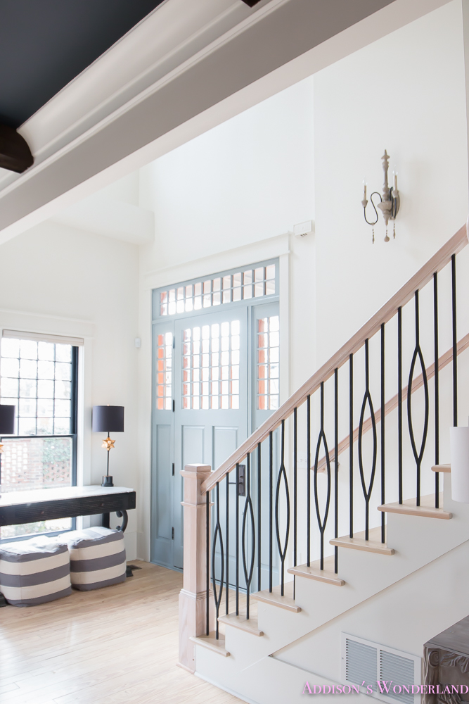 foyer-white-walls-blue-front-foor-uncertain-grey-stardew-alabaster-sherwin-williams-iron-baluster-staircase-whitewashed-hardwood-floors-5-of-13