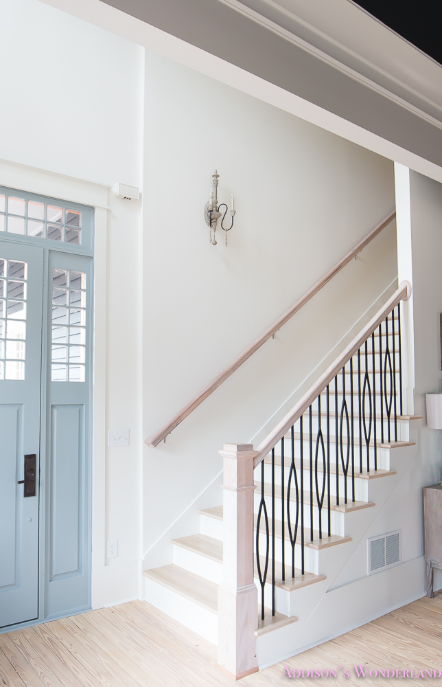 foyer-white-walls-blue-front-foor-uncertain-grey-stardew-alabaster-sherwin-williams-iron-baluster-staircase-whitewashed-hardwood-floors-6-of-13