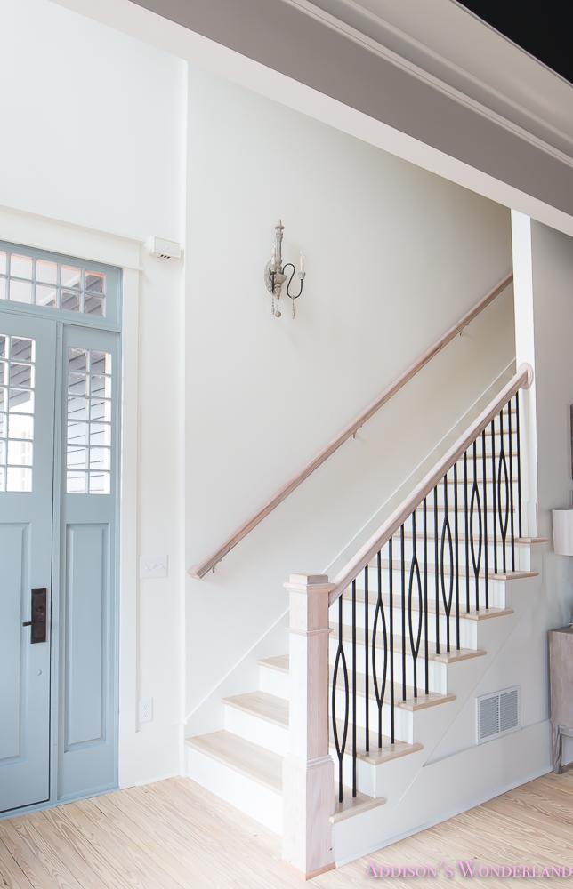 foyer-white-walls-blue-front-foor-uncertain-grey-stardew-alabaster-sherwin-williams-iron-baluster-staircase-whitewashed-hardwood-floors-6-of-13