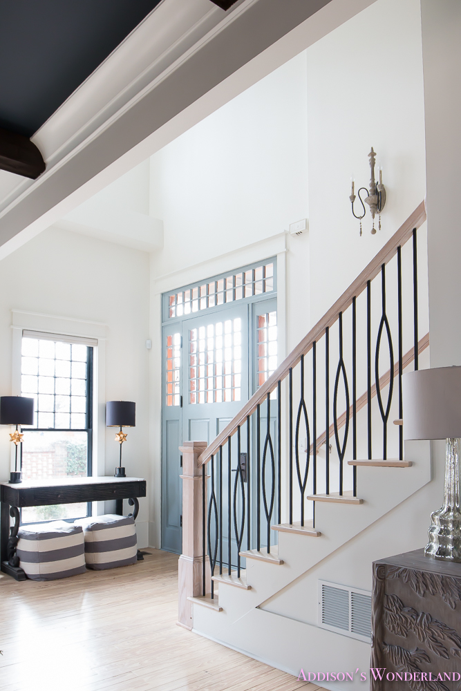 foyer-white-walls-blue-front-foor-uncertain-grey-stardew-alabaster-sherwin-williams-iron-baluster-staircase-whitewashed-hardwood-floors-7-of-13