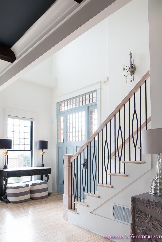 foyer-white-walls-blue-front-foor-uncertain-grey-stardew-alabaster-sherwin-williams-iron-baluster-staircase-whitewashed-hardwood-floors-7-of-13