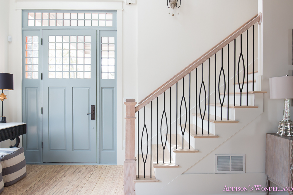 foyer-white-walls-blue-front-foor-uncertain-grey-stardew-alabaster-sherwin-williams-iron-baluster-staircase-whitewashed-hardwood-floors-9-of-13