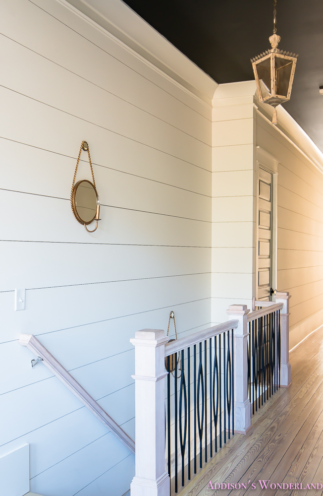 hallway-white-walls-shiplap-black-ceiling-alabaster-inkwell-lantern-chateau-blue-door-stardew-uncertain-grey-whitewashed-hardwood-flooring-11-of-15