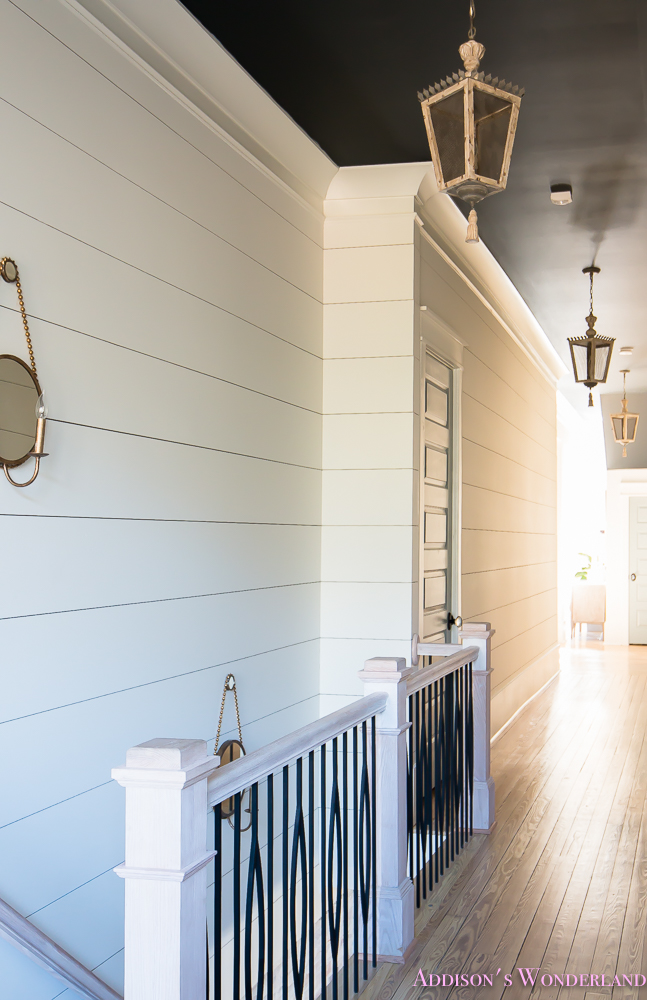 hallway-white-walls-shiplap-black-ceiling-alabaster-inkwell-lantern-chateau-blue-door-stardew-uncertain-grey-whitewashed-hardwood-flooring-12-of-15