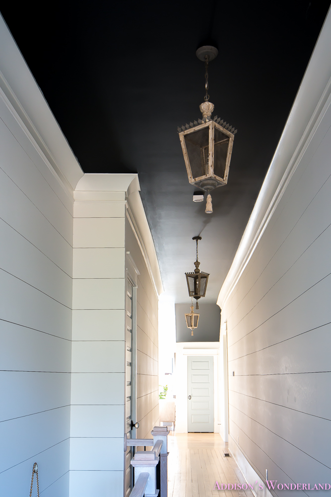 hallway-white-walls-shiplap-black-ceiling-alabaster-inkwell-lantern-chateau-blue-door-stardew-uncertain-grey-whitewashed-hardwood-flooring-13-of-15
