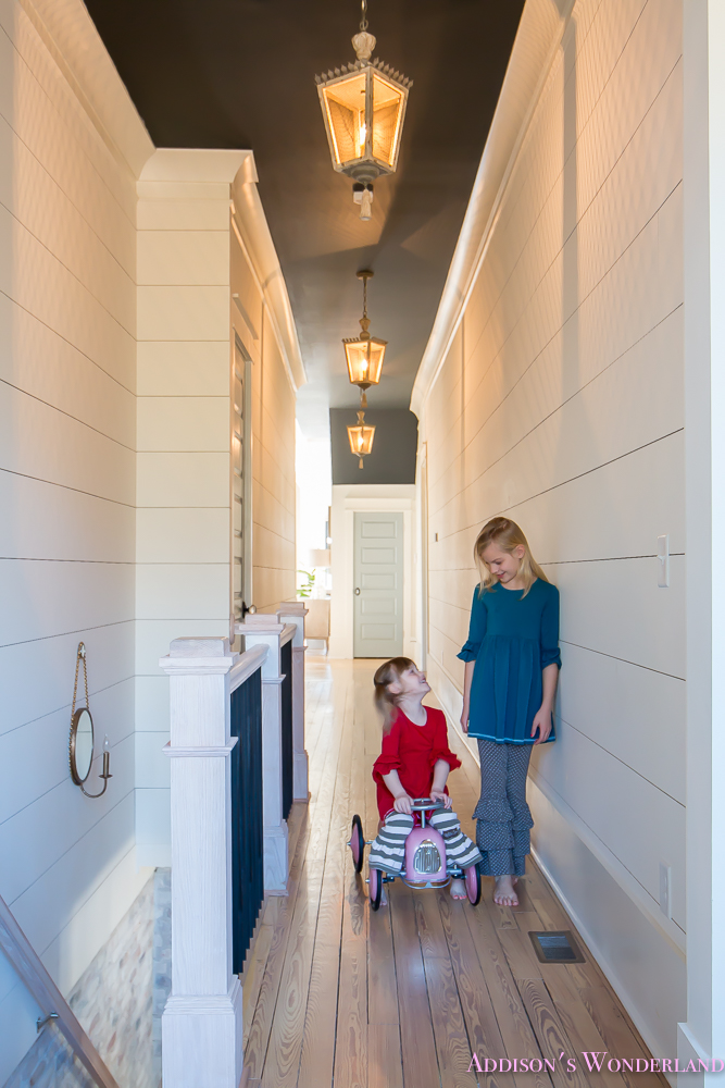 hallway-white-walls-shiplap-black-ceiling-alabaster-inkwell-lantern-chateau-blue-door-stardew-uncertain-grey-whitewashed-hardwood-flooring-14-of-15