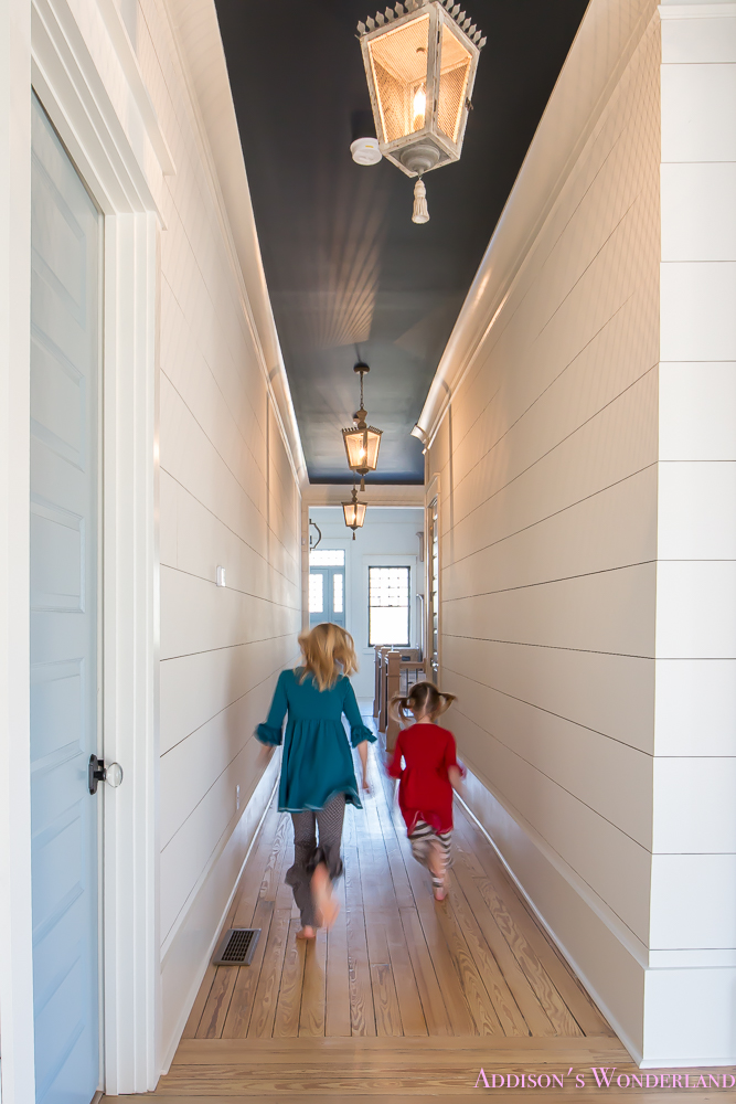 hallway-white-walls-shiplap-black-ceiling-alabaster-inkwell-lantern-chateau-blue-door-stardew-uncertain-grey-whitewashed-hardwood-flooring-15-of-15