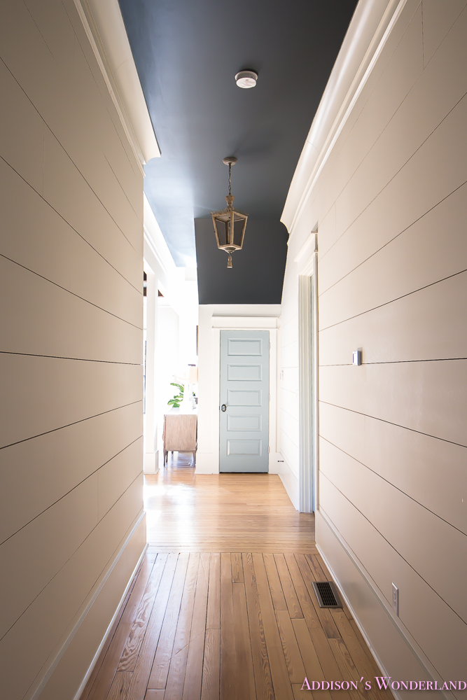 Hallway White Walls Shiplap Black Ceiling Alabaster Inkwell Lantern Chateau Blue Door Stardew Uncertain Grey Whitewashed Hardwood Flooring 5 Of 15