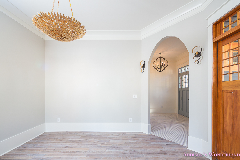 Living Room Light Gray Grey Walls White Trim Gold Chandelier Arched Doorway Craftsman Door Gossamer Veil Alabaster Whitewashed Hardwood Flooring Floors 1 Of