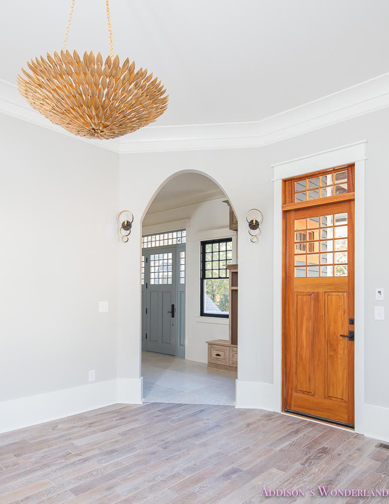 Living Room Light Gray Grey Walls White Trim Gold Chandelier Arched Doorway Craftsman Door Gossamer Veil Alabaster Whitewashed Hardwood Flooring Floors 2 Of