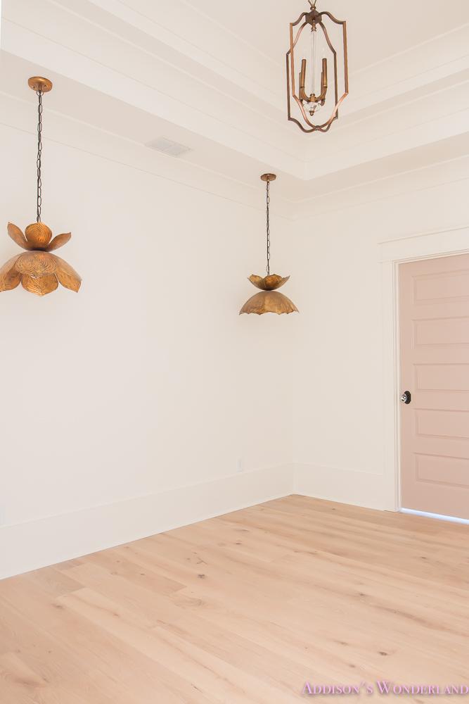playroom-living-room-whitewashed-hardwood-floors-flooring-ceiling-rose-pink-doors-iron-baluster-staircase-white-walls-alabaster-sherwin-williams-1-of-19