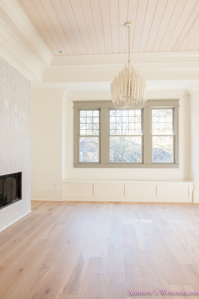 playroom-living-room-whitewashed-hardwood-floors-flooring-ceiling-rose-pink-doors-iron-baluster-staircase-white-walls-alabaster-sherwin-williams-10-of-19