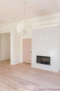 playroom-living-room-whitewashed-hardwood-floors-flooring-ceiling-rose-pink-doors-iron-baluster-staircase-white-walls-alabaster-sherwin-williams-14-of-19