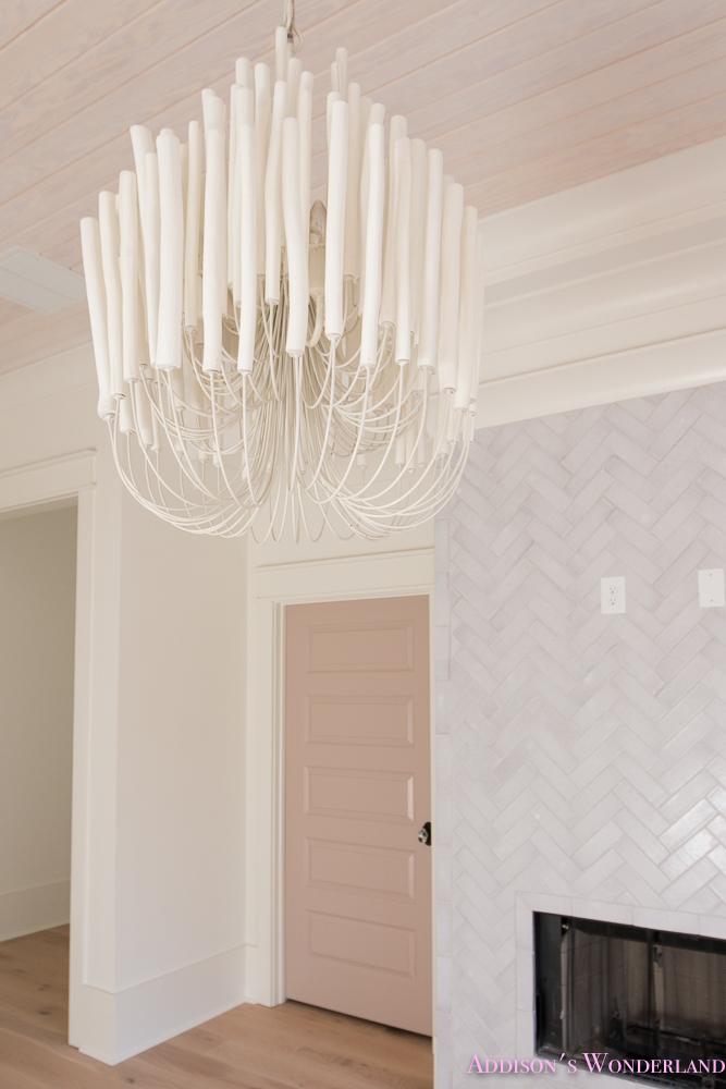 playroom-living-room-whitewashed-hardwood-floors-flooring-ceiling-rose-pink-doors-iron-baluster-staircase-white-walls-alabaster-sherwin-williams-15-of-19