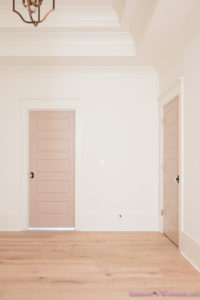 playroom-living-room-whitewashed-hardwood-floors-flooring-ceiling-rose-pink-doors-iron-baluster-staircase-white-walls-alabaster-sherwin-williams-3-of-19