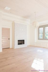 playroom-living-room-whitewashed-hardwood-floors-flooring-ceiling-rose-pink-doors-iron-baluster-staircase-white-walls-alabaster-sherwin-williams-4-of-19