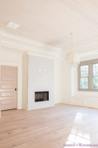 playroom-living-room-whitewashed-hardwood-floors-flooring-ceiling-rose-pink-doors-iron-baluster-staircase-white-walls-alabaster-sherwin-williams-5-of-19