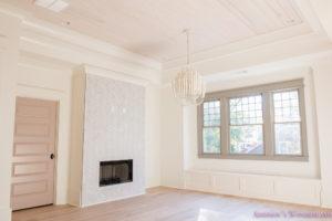 playroom-living-room-whitewashed-hardwood-floors-flooring-ceiling-rose-pink-doors-iron-baluster-staircase-white-walls-alabaster-sherwin-williams-6-of-19