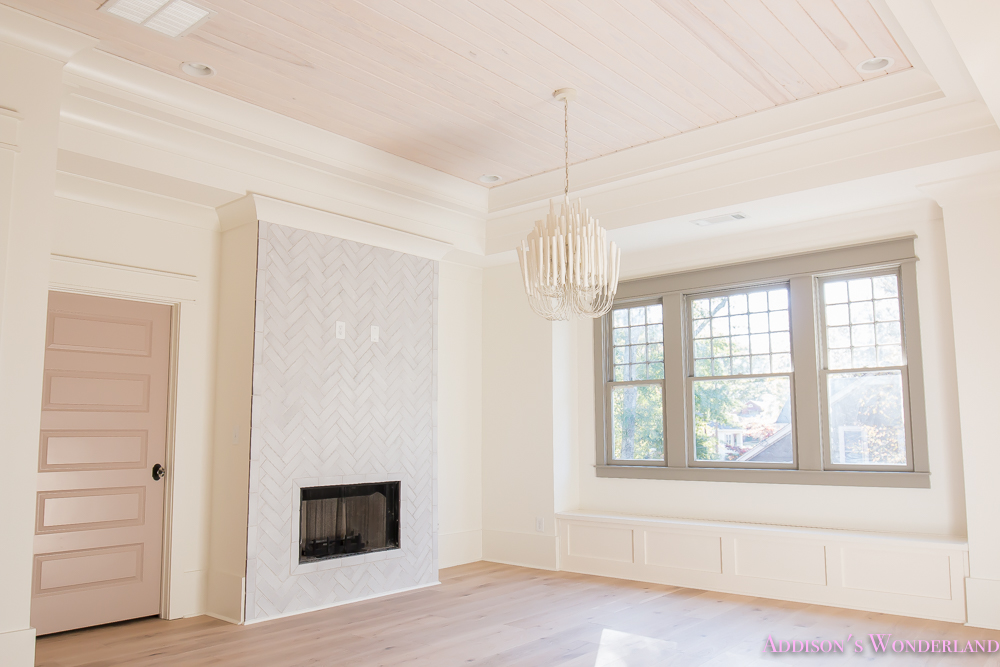 playroom-living-room-whitewashed-hardwood-floors-flooring-ceiling-rose-pink-doors-iron-baluster-staircase-white-walls-alabaster-sherwin-williams-6-of-19